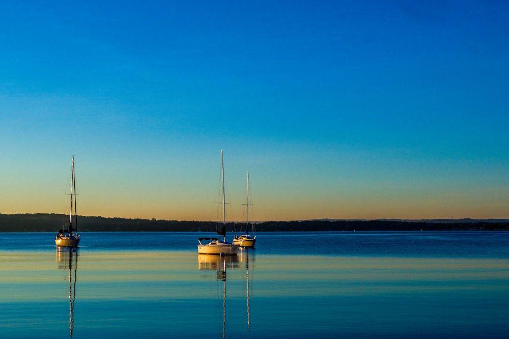 Photo in Landscape #sunrise #water #boats #michigan