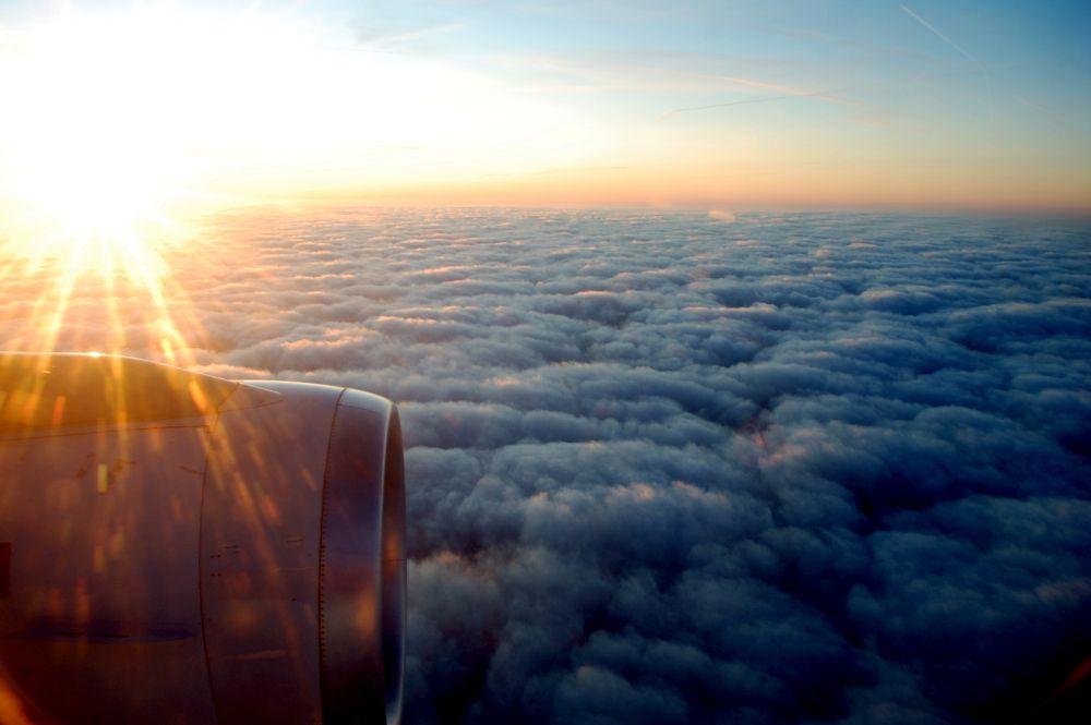 Photo in Random #flying #clouds #plane #sun