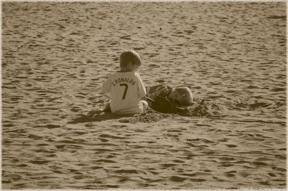 Photo in Family #beach #family #playing #california #sand #santa cruz #brothers